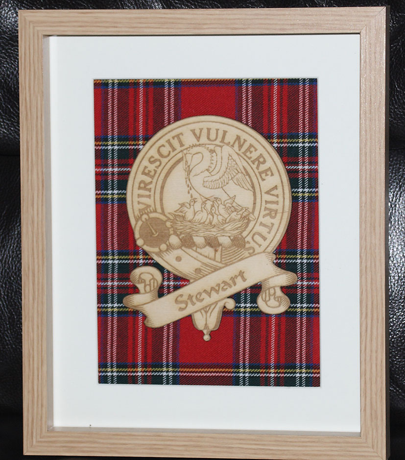 Engraved Clan crest on custom tartan
