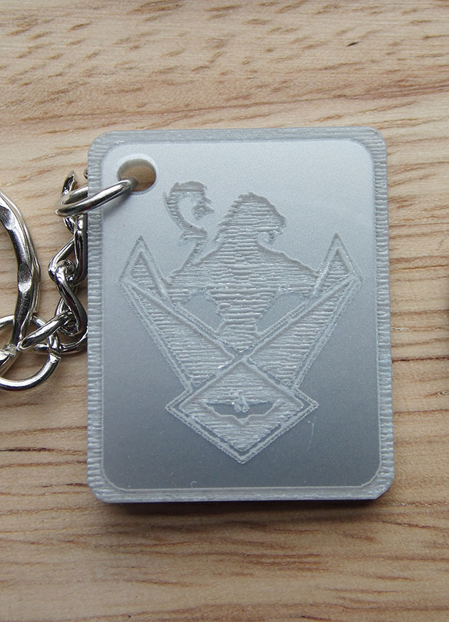 Silver metallic WOS Shield Key Ring